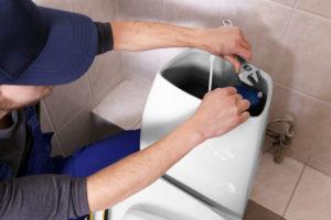 Plumber Repairing Leaky Toilet in Frederick MD