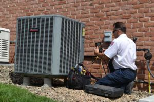 Larry & Sons' Technician Fixing HVAC Unit