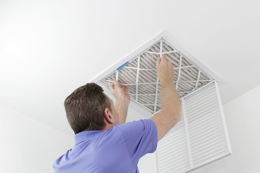 Man Changing a Furnace Filter in Hagerstown